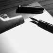 photo of clipboard and pen for assessment services regarding corporate communications training by Voso Impact