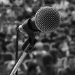 microphone on stage photo for presentations and programs communications training services by Voso Impact